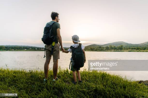 exploring the nature - single father stock pictures, royalty-free photos & images