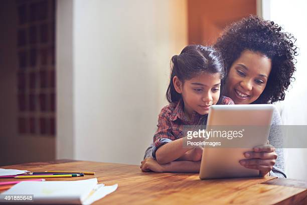 exploring the online world with mom - one parent stock pictures, royalty-free photos & images