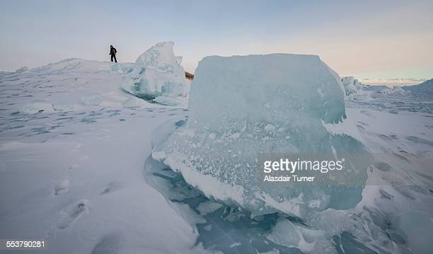 Exploring the top of an iceberg frozen into the surface of the Ross Sea, Antarctica.