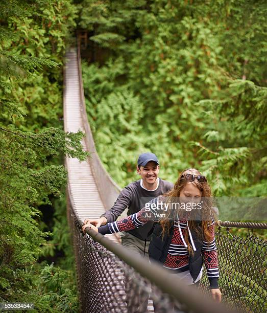 exploring their natural environment - suspension bridge stock photos and pictures