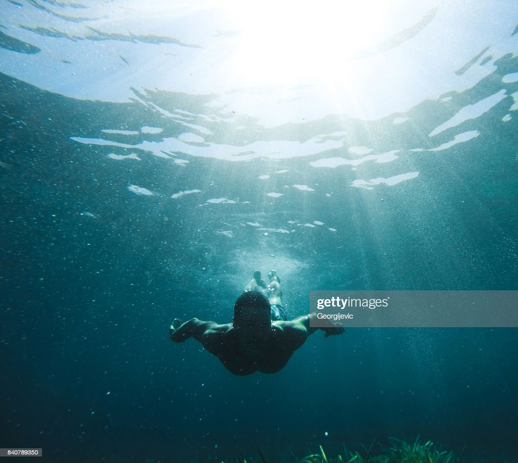 Exploring under the water : Stock Photo