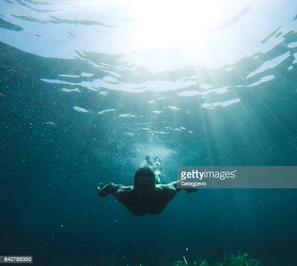 exploring under the water - diving into water stock photos and pictures