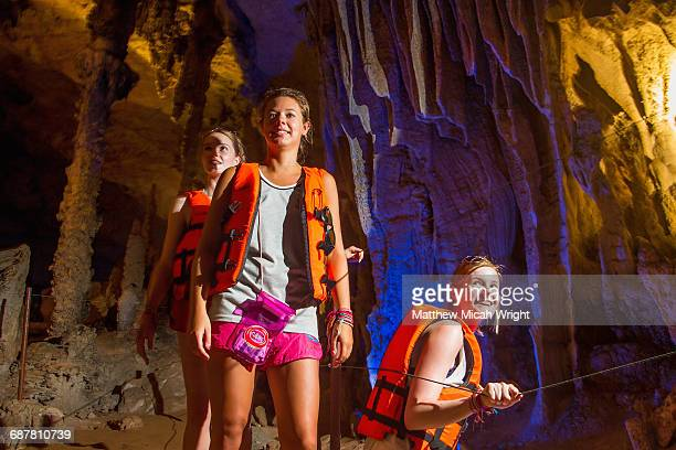 exploring underground caves in kong lor. - spelunking stock pictures, royalty-free photos & images