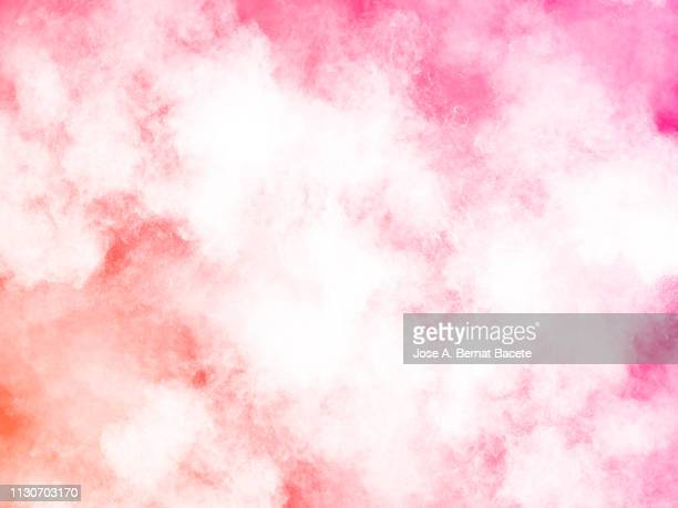 explosion by an impact of a cloud of particles of powder and smoke of color white on a pink background. - explosives stock photos and pictures