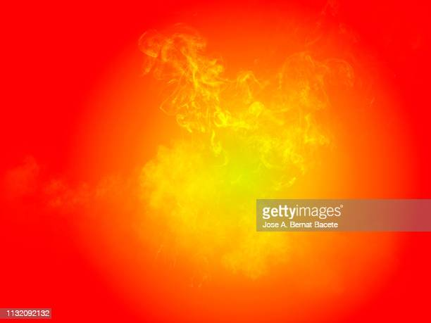 explosion by an impact of a cloud of particles of powder and smoke of color yellow on a orange background. - orange background stock pictures, royalty-free photos & images