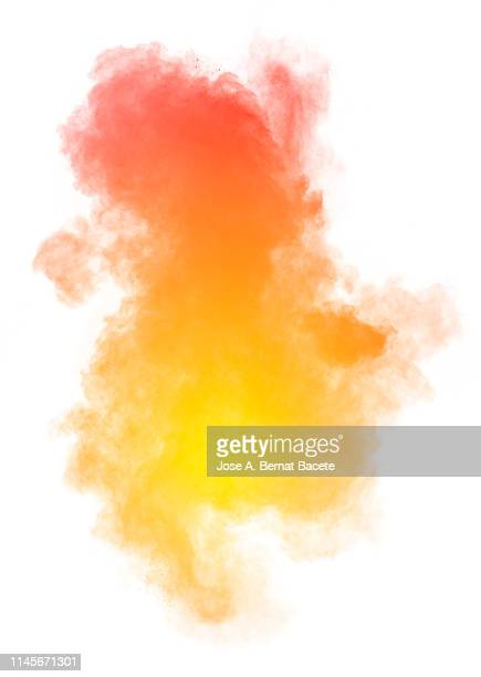 explosion by an impact of a cloud of particles of powder and smoke of color orange on a white background. - explosive stock pictures, royalty-free photos & images