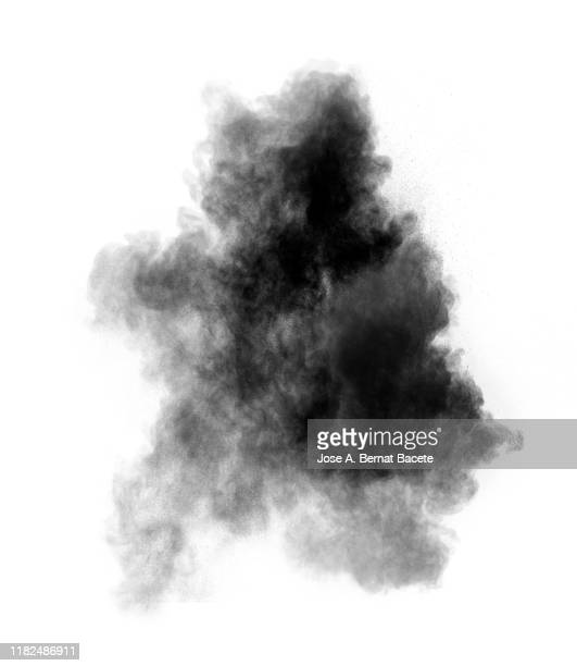 explosion by an impact of a cloud of particles of powder and smoke of color black on a white background. - 煙 ストックフォトと画像