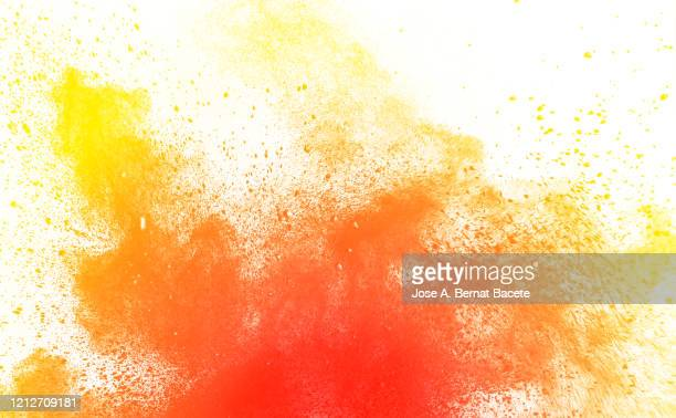 explosion by an impact of a cloud of particles of powder and smoke of orange color on a white background. - 燃える ストックフォトと画像