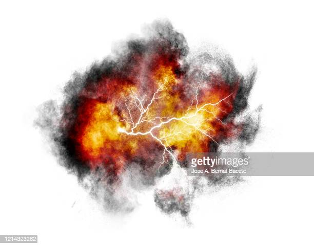 explosion by an impact of a cloud of particles of powder and smoke of multicolored on a white background. - explosive material ストックフォトと画像