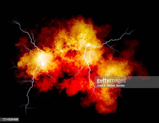 explosion by an impact of a cloud of particles of powder and smoke of multicolored on a black background. - burning stock pictures, royalty-free photos & images
