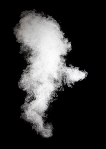 Explosion by an impact of a cloud of particles of powder of color white on a black background. - gettyimageskorea