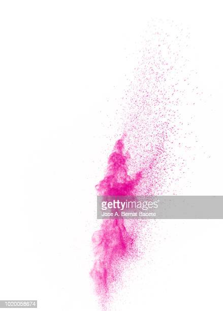 Explosion by an impact of a cloud of particles of powder of color pink on a white background.