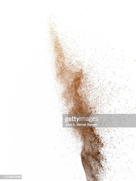 explosion by an impact of a cloud of particles of powder of color brown on a white background. - arena fotografías e imágenes de stock