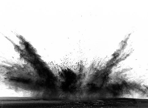 Explosion by an impact of a cloud of particles of powder of color black on a white background. - gettyimageskorea