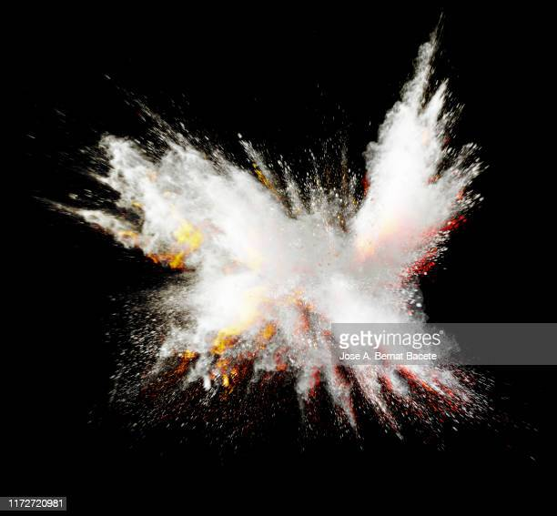 explosion by an impact of a cloud of particles of powder of color white on a black background. - 画像効果 ストックフォトと画像