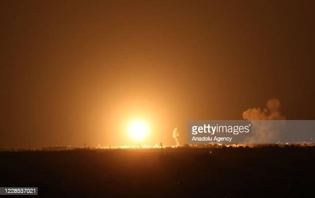 Explosion illuminates the night sky after Israeli warplanes hit several targets of Izz ad-Din al Qassam Brigades on September 16, 2020 in Khan Yunis,...