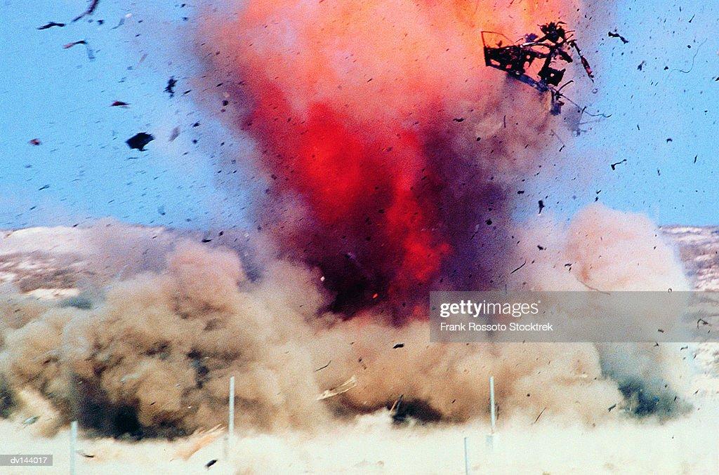 Explosion in desert : Stock Photo