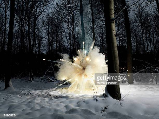 explosion in snowy forest