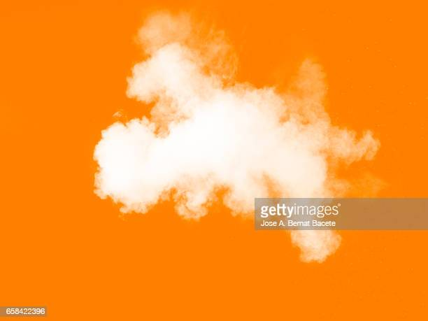 Explosion of a cloud of powder of particles of  color white on a black background