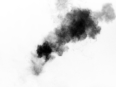Explosion of a cloud of powder of particles of  colors gray and black on a white background - gettyimageskorea
