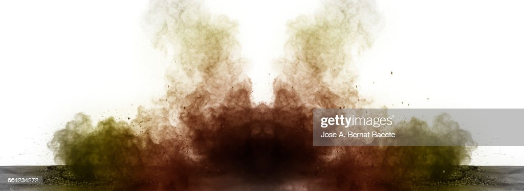 Explosion of a cloud of powder of particles of  colors gray and orange on a white background : Stock Photo