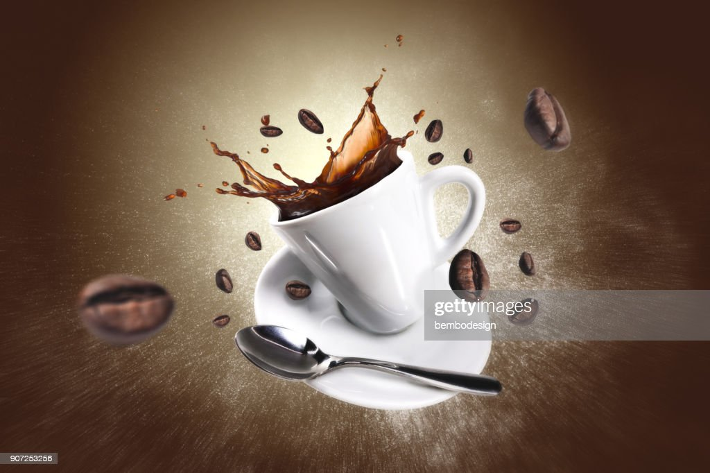 Explosion of coffee with a cup and beans : Stock Photo