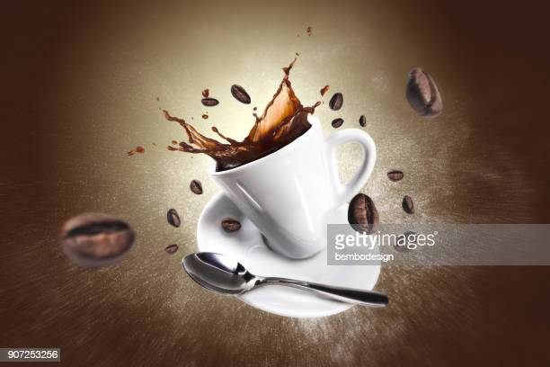 explosion of coffee with a cup and beans - ground coffee stock photos and pictures