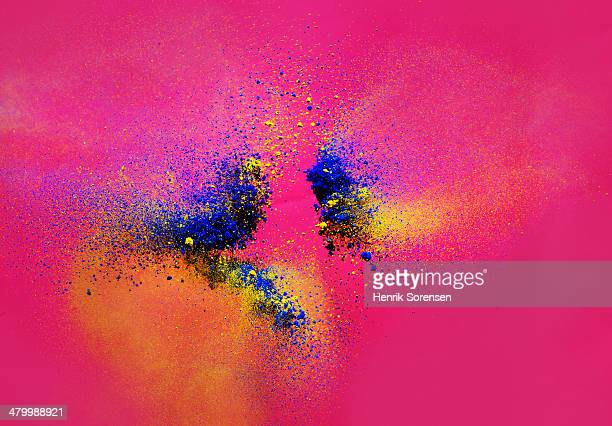 explosion of colored powder - detonate stock photos and pictures