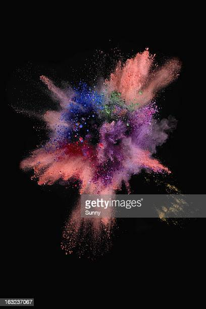 Explosion of colorful sand on black background