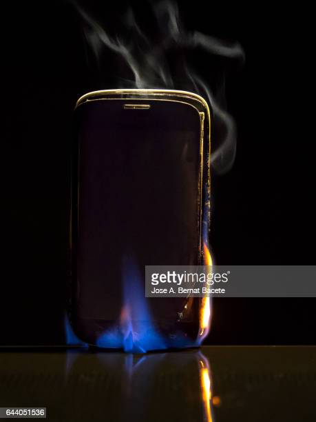Explosion of mobile phone in flames for a breakdown