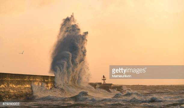 explosion of wave in lesconil - levee stock pictures, royalty-free photos & images