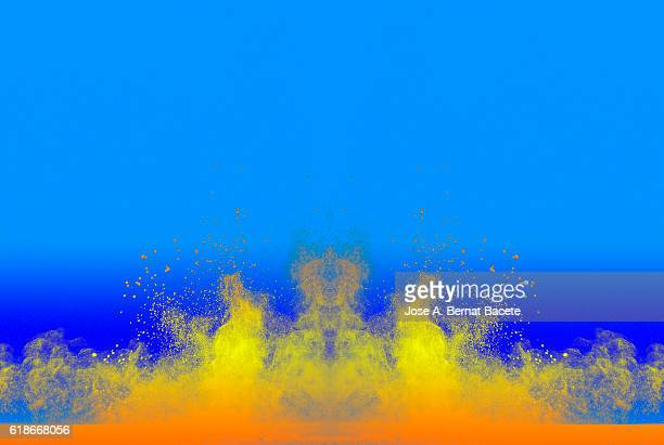 Explosion particles of white powder on a blue background