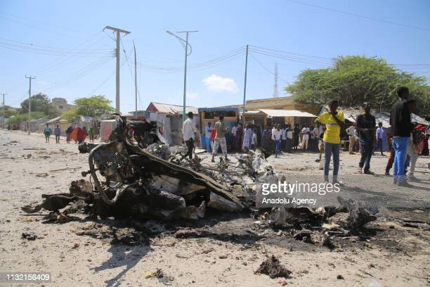 Explosion site is seen after a terror attack carried out by AlQaedaaffiliated terrorist group alShabaab with a bombladen vehicle near two ministry...