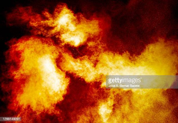 explosion with fire, smoke and  sparks on a black background - shooting a weapon stock pictures, royalty-free photos & images