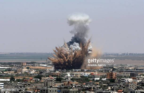 Explosions and black smoke are seen after an Israeli air attack, staged at the morning hours, to the city center of Gaza City, Gaza on july 8, 2014.