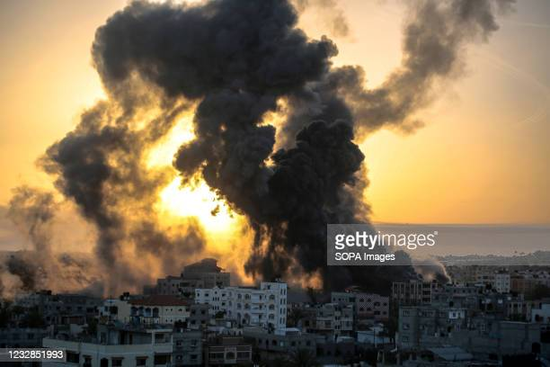 Explosions, fire and flames by Israeli air strikes over southern Gaza Strip in response to the barrage of rockets fired by the Palestinians into...