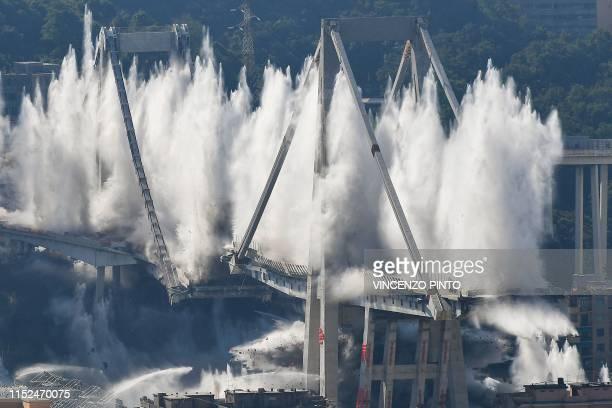 Explosive charges blow up the eastern pylons of Genoa's Morandi motorway bridge on June 28, 2019 in Genoa. - Some of the remains of Genoa's Morandi...