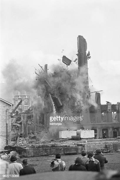 Explosive experts of the 3rd Field Squadron of Royal Engineers demolish a 130 foot tower named 'Big Lizzie', part of a ravaged warehouse in the riot...