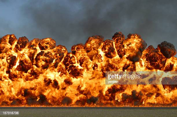 explosive wall of fire and smoke - explosives stock photos and pictures