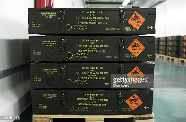Explosive warning signs sit on shipping crates for 122mm M60 smoke shells at the staterun Sloboda AD ammunitions plant in Cacak Serbia on Wednesday...