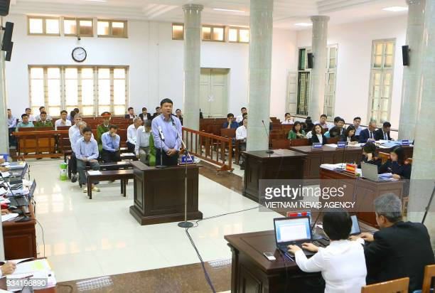 ExPolitburo member Dinh La Thang stands trial for corruption in Hanoi on March 19 2018 Thang the former head of staterun oil giant PetroVietnam is...