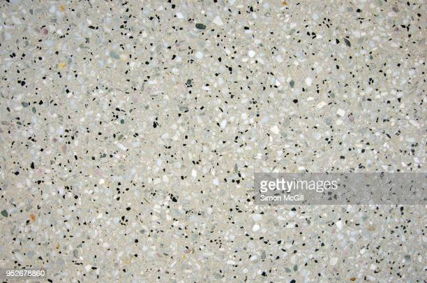 exposed aggregate polished cement - spotted stock pictures, royalty-free photos & images