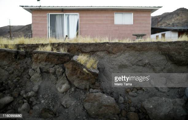 Exposed earth is seen where a cinderblock wall was toppled outside the Eldridge family home which has been deemed uninhabitable due to structural...