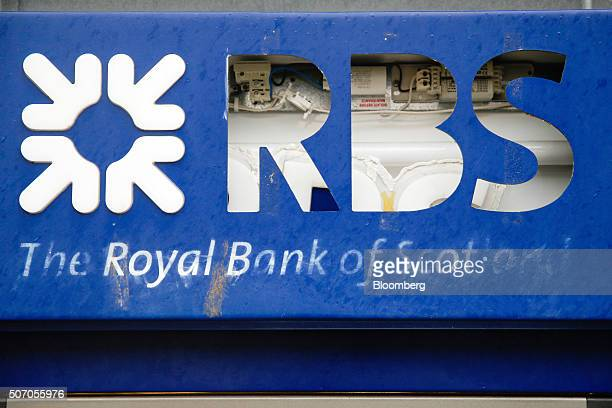 Exposed electrical components sit behind a logo on a damaged automated teller machine outside a closed Royal Bank of Scotland Group Plc bank branch...