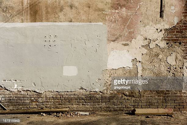 exposing brick - alley stock photos and pictures