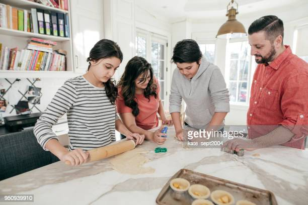 exposing teens to baking. - creole ethnicity stock pictures, royalty-free photos & images