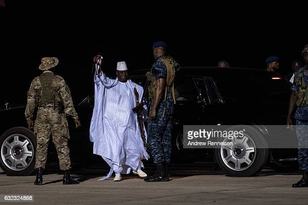 ExPresident Yahyah Jammeh waves to a crowd of supporters before leaving the country on January 21 2017 at Banjul International Airport in Banjul The...