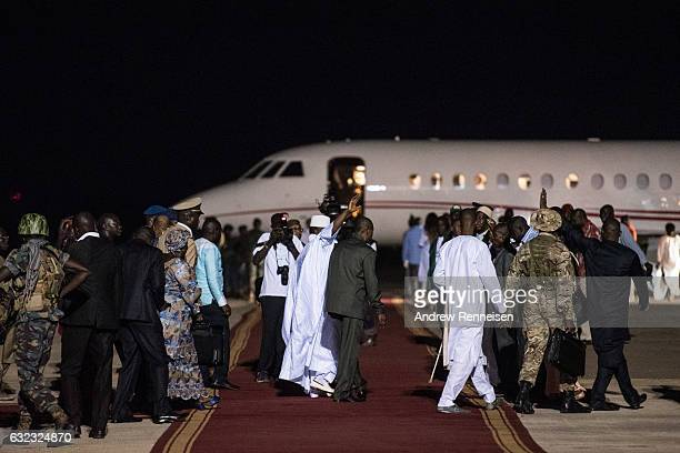Ex-President Yahyah Jammeh waves to a crowd of supporters before leaving the country on January 21, 2017 at Banjul International Airport in Banjul,...