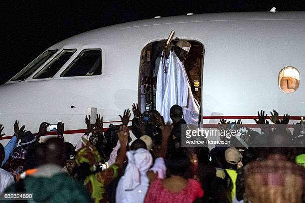 ExPresident Yahyah Jammeh waves to a crowd of supporters before leaving the country on January 21 2017 at Banjul International Airport in Banjul...