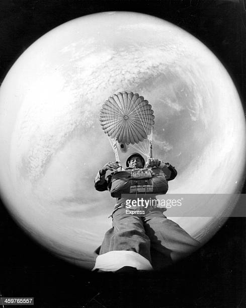 Express cameraman Terry Fincher in Training- and the fish-eye lens of a camera strapped to his foot captures a unique self-portrait. April 19,1966.